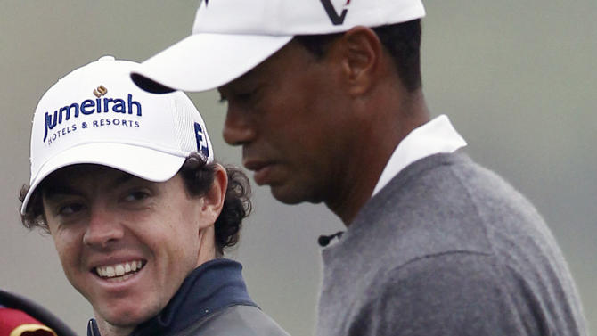 FILE - This Oct. 29, 2012 file photo shows Tiger Woods, right, and Rory McIlroy walking together during their 18-hole medal-match at the Lake Jinsha Golf Club in Zhengzhou, in central China's Henan province. A little more than three months ago, Woods was on his way back to the top of golf with only time in his way. So much has changed. (AP Photo/Alexander F. Yuan, File)