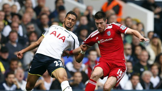 Tottenham Hotspur's Chadli challenges West Bromwich Albion's Pocognoli during their English Premier League soccer match at White Hart Lane in London