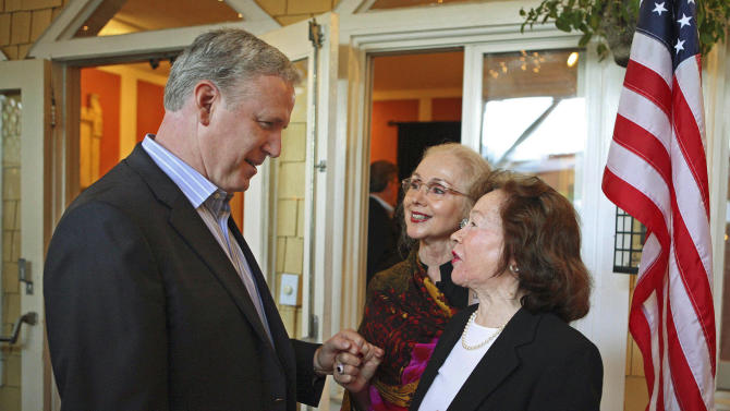 FILE - In this Oct. 13, 2010 file photo, Republican candidate for the U.S. Senate, John Dennis, left, speaks with Nob Hill Republican Women's Club president Joan Leone, center, and vice president Barbara Kerwick in San Francisco. Dennis is running against House Speaker Nancy Pelosi in her heavily Democratic San Francisco congressional district, and is one of the hundreds of sacrificial lambs will hit the campaign trail in 2012 against heavily favored incumbents. (AP Photo/Ben Margot, File)