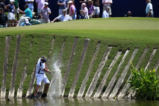 Daniel Chopra, of Sweden, hits out of a lagoon back onto the ninth green during the third round of the Zurich Classic golf tournament at TPC Louisiana in Avondale, La., Saturday, April 28, 2012. (AP Photo/Gerald Herbert)