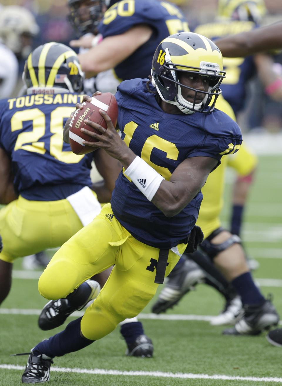 Michigan quarterback Denard Robinson (16) runs during the second quarter of an NCAA college football game against Purdue in Ann Arbor, Mich., Saturday, Oct. 29, 2011. (AP Photo/Carlos Osorio)