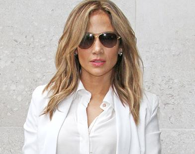 Jennifer Lopez flaunts her studded red boots as she promotes her new single 'Live It Up' at Capital Radio and BBC Radio 1 in London