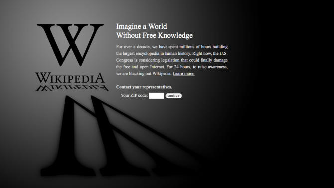 """This screen shot shows the blacked-out Wikipedia website, announcing a 24-hour protest against proposed legislation in the U.S. Congress, intended to protect intellectual property that critics say could facilitate censorship, referred to as the """"Stop Online Piracy Act,"""" or """"SOPA,"""" and the """"Protect IP Act,"""" or """"PIPA."""" (AP Photo/Wikipedia)"""