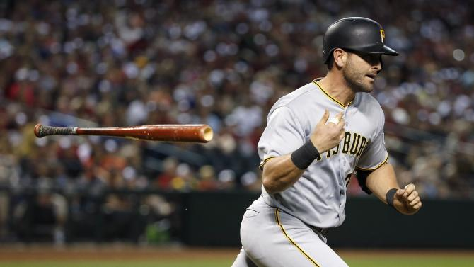 Pittsburgh Pirates' Francisco Cervelli tosses his bat away as he flies out during the ninth inning of a baseball game against the Arizona Diamondbacks Saturday, April 25, 2015, in Phoenix.  The Pirates defeated the Diamondbacks 2-1. (AP Photo/Ross D. Franklin)