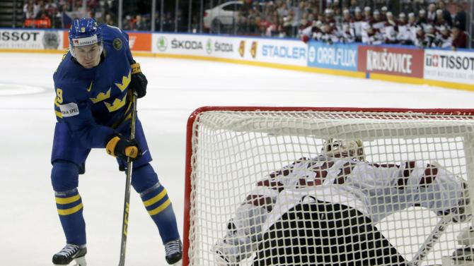 Sweden's Forsberg scores a penalty shot against Latvia's goaltender Masalskis during their Ice Hockey World Championship game at the O2 arena in Prague
