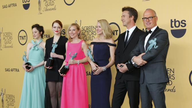 "The cast of ""Birdman"" pose backstage with their award for Outstanding Performance by a Cast in a Motion Picture at the 21st annual Screen Actors Guild Awards in Los Angeles"