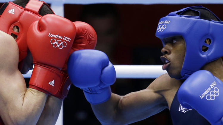 USA's Errol Spence fights Brazil's Myke Ribeiro de Carvalho during their men's welter 69-kg boxing match at the 2012 Summer Olympics, Sunday, July 29, 2012, in London. (AP Photo/Patrick Semansky)