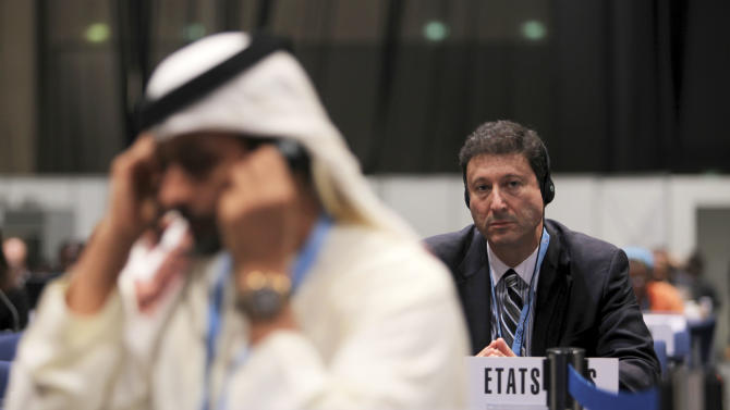 Terry Kramer, head of the U.S. delegation, right, listens to a speech at the final day of World Conference on International Telecommunications in Dubai, United Arab Emirates, Friday Dec. 14, 2012. Envoys in Dubai signed a new U.N. telecommunications treaty Friday that a U.S.-led delegation says endorses greater government control of the Internet. The U.S. and more than 20 other countries refused to ratify the accord by the 193-nation International Telecommunications Union.(AP Photo/Kamran Jebreili)