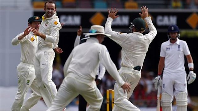 Australia's Nathan Lyon (2nd L) celebrates with George Bailey (L) after he took the wicket of England's captain Alastair Cook in the first Test (Reuters)