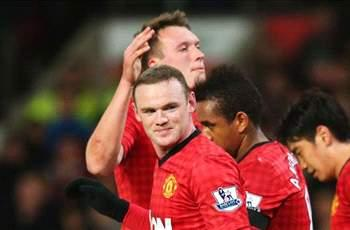 Manchester United 2-1 Southampton: Rooney fires twice to extend league lead