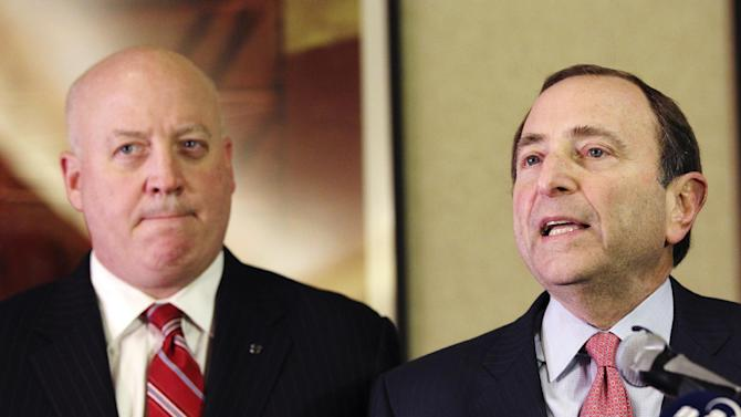 FILE - In this Dec. 6, 2012, file photo, NHL Commissioner Gary Bettman, right, and deputy commissioner Bill Daly speak to reporters in New York. The NHL made a new proposal to the players' association, hoping to spark talks to end the long lockout and save the hockey season. Daly said Friday, Dec. 28, 2012, the league made its offer Thursday and was waiting for a response. (AP Photo/Mary Altaffer, File)