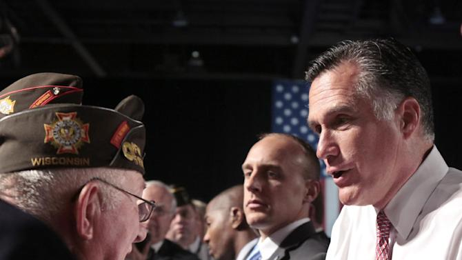 Republican presidential candidate, former Massachusetts Gov. Mitt Romney meets with members of the Veterans of Foreign Wars after his speech at the VFW national convention in Reno, Nev. ,Tuesday July 24, 2012.(AP Photo/Rich Pedroncelli)