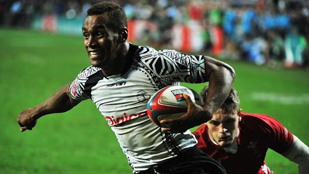 Fiji's Osea Kolinisau (L) evades a tackle by Wales' Cory Allen to score a try during the Hong Kong Rugby Sevens