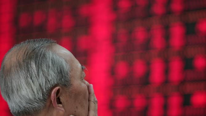 An investor looks at the stock price monitor at a private securities company Friday, June 1, 2012 in Shanghai, China. World stock markets fell Friday ahead of the release of key U.S. jobs data, as weakness in Chinese manufacturing suggested the slowdown in the world's No. 2 economy may worsen. (AP Photo)