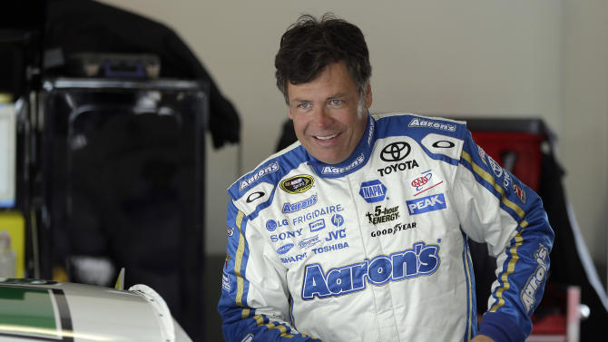 Michael Waltrip prepares to climb into his car during a practice session for the NASCAR Sprint Cup Series Daytona 500 auto race Friday, Feb. 22, 2013, at the Daytona International Speedway in Daytona Beach, Fla. (AP Photo/Chris O'Meara)