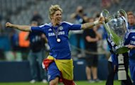 Chelsea's Spanish forward Fernando Torres celebrates with the trophy after winning the UEFA Champions League on May 19. Torres has cast doubt over his future at the newly-crowned European champions, labelling this past season as the most difficult of his career