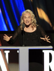 FILE - In this April 14, 2012 file photo, singer Carole King introduces Don Kirshner for the Ahmet Ertegun Award at induction ceremonies for the Rock and Roll Hall of Fame in Cleveland. King, now a best-selling author, doubts she will ever write another song and suggested that her 2010 &quot;Troubadours Reunion&quot; concert tour with James Taylor would be her last. She recently released a memoir called, &quot;A Natural Woman.&quot; (AP Photo/Tony Dejak, file)