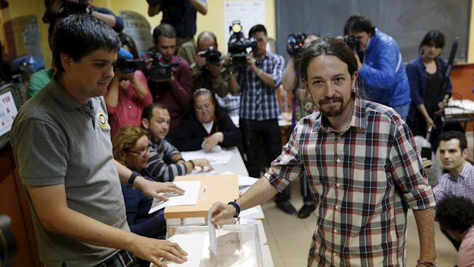 Podemos (We Can) leader Iglesias poses before casting his vote at a polling station during regional and municipal elections in Madrid