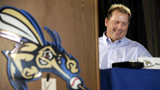 Roger Clemens smiles during a news conference officially announcing his signing with the Sugar Land Skeeters baseball team Tuesday, Aug. 21, 2012, in Sugar Land, Texas. Clemens, a seven-time Cy Young Award winner, signed with the Skeeters of the independent Atlantic League on Monday and is expected to start for the minor league team on Saturday at home against Bridgeport. (AP Photo/David J. Phillip)