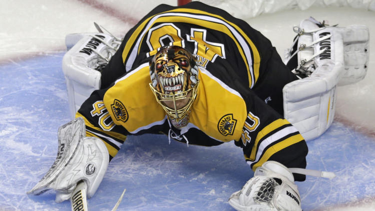 Boston Bruins goalie Tuukka Rask drops to the ice for the puck, against the Pittsburgh Penguins during the second period in Game 3 of the NHL hockey Stanley Cup playoffs Eastern Conference finals, in Boston on Wednesday, June 5, 2013. (AP Photo/Charles Krupa)