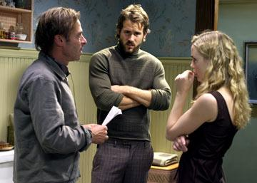 Director Andrew Douglas , Ryan Reynolds and Melissa George on the set of MGM's The Amityville Horror