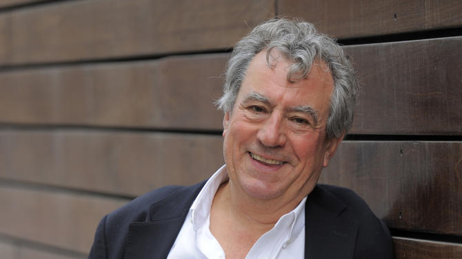 "FILE - In this Sept. 7, 2012 file photo, Monty Python alumnus Terry Jones, featured in the 3-D animated film ""A Liar's Autobiography -- The Untrue Story of Monty Python's Graham Chapman,"" poses for a portrait at the 2012 Toronto Film Festival, in Toronto. Jones thinks Chapman would have loved the cryptic mishmash of observations, self-analysis, bizarre asides, flights of fancy and revisionist personal history that make up the film. (Photo by Chris Pizzello/Invision/AP, File)"