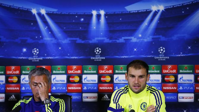 Chelsea's manager Mourinho reacts as Ivanovic speaks during a news conference in Cobham