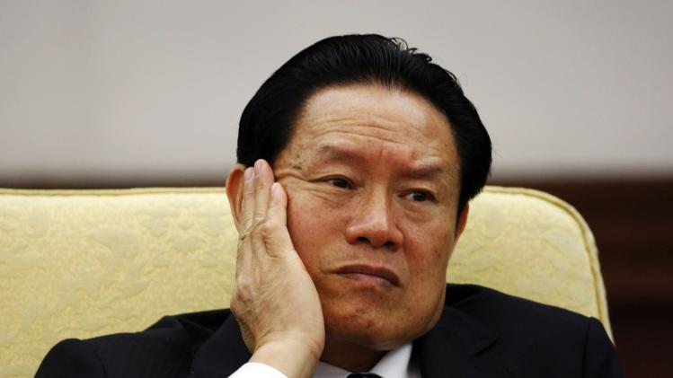 File photo of then China's Public Security Minister Zhou Yongkang reacting as he attending the Hebei delegation discussion sessions at the 17th National Congress of the Communist Party of China at the Great Hall of the People