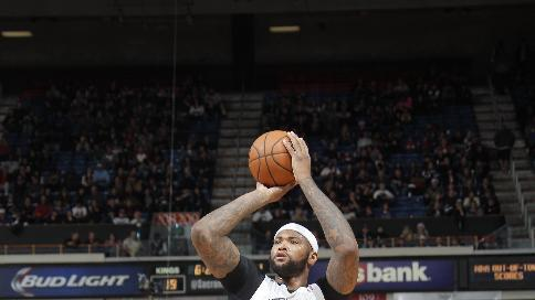 Cousins powers Kings to 112-97 win over Mavericks