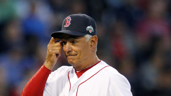 Boston Red Sox manager Bobby Valentine walks back to the dugout after removing pitcher Alfredo Aceves in the eighth inning of a baseball game against the New York Yankees in Boston, Saturday, April 21, 2012. (AP Photo/Michael Dwyer)