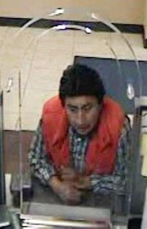 In this image taken from surveillance video and provided by the New York City Police Department, an unidentified man who tries to withdraw funds from the bank account of New York City accountant Pedro Portugal is shown. Portugal was snatched from a city street in broad daylight, and then held captive for more than a month in an attempt to extort ransom from his family in Ecuador. Detectives rescued Portugal on May 20 after noticing a light upstairs in an otherwise dark Queens, N.Y. warehouse. (AP Photo/New York City Police Department)