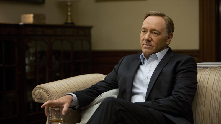 "FILE -This file image released by Netflix shows Kevin Spacey in a scene from the Netflix original series, ""House of Cards,"" an adaptation of a British classic. Netflix reports quarterly earnings on Monday, July 22, 2013. (AP Photo/Netflix, Melinda Sue Gordon)"