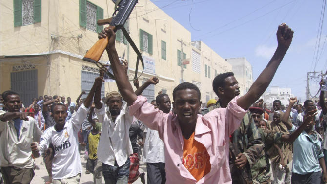 Protesters shout slogans in Mogadishu, Somalia, Friday, June 10, 2011, where they took to the streets for the second day in support of current Prime Minister Mohamed Abdullahi Farmajo. A new accord extending the government's term by a year requires Prime Minister Mohamed Abdullahi Mohamed to resign in a month, but  Mohamed is popular with many Somalis because he has managed to pay salaries for government workers and soldiers and attack corruption since he came to power in October last year. (AP Photo/Mohamed Sheikh Nor)         ?