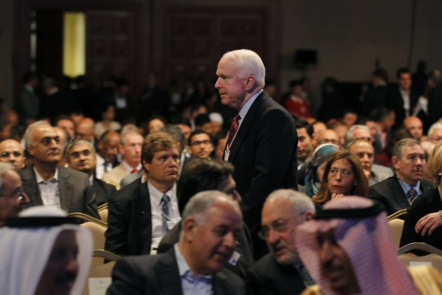 U.S. Senator John McCain walks after the opening ceremony of the World Economic Forum on the Middle East and North Africa at the Dead Sea