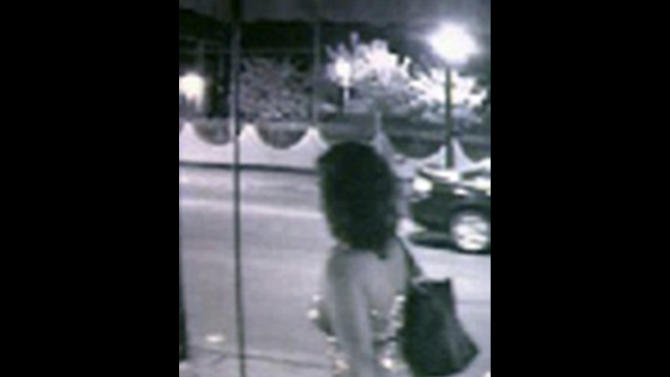 This surveillance photo taken Friday, May 11, 2012 and provided by the Burbank Police Department, shows Estrella Carrera, 26, of Burbank, Ill., walking out of a restaurant during her wedding celebration. Estrella was found stabbed to death in her bathtub shortly after she and her husband, Arnoldo Jimenez, 32, celebrated their wedding with friends. Jimenez is accused of first-degree murder in the slaying and the subject of a manhunt by the FBI and 32 law enforcement agencies. (AP Photo/Burbank Police Department)