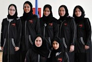 "Members of the first female Saudi basketball team ""Jeddah United"" pose for a team picture in the Red Sea port city of Jeddah in March 2102. Women wanting to take part in sports in the Gulf kingdom face an uphill struggle as they have to do so behind closed doors, like a group of 300 women who played basketball at an enclosed court in the city of Jeddah on the occasion of International Women's Day"