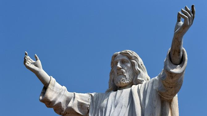 The nine-metre tall statue of Jesus Christ carved from white marble, thought to be the biggest of its kind in Africa, is unveiled in Abajah, southeastern Nigeria on January 1, 2016