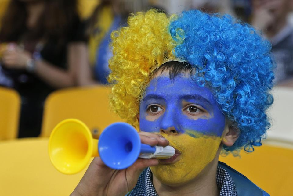 A Ukraine fan blows a plastic trumpet prior to the Euro 2012 soccer championship Group D match between Ukraine and Sweden in Kiev, Ukraine, Monday, June 11, 2012. (AP Photo/Efrem Lukatsky)