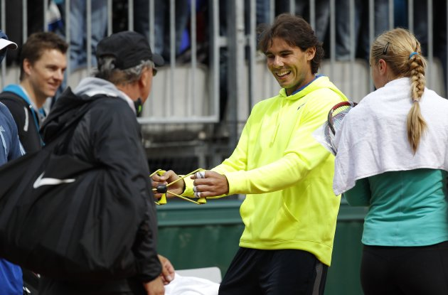 Nadal of Spain warms up for a training session at the French Open tennis tournament at the Roland Garros stadium in Paris