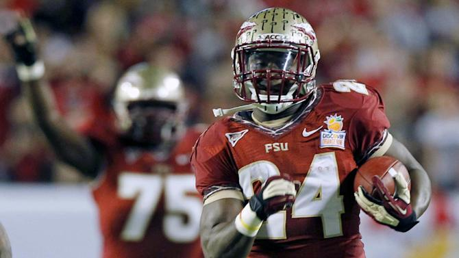 Florida State fullback Lonnie Pryor (24) runs 60 yards for a touchdown during the first half of the Orange Bowl NCAA college football game against the Northern Illinois, Tuesday, Jan. 1, 2013, in Miami. (AP Photo/Alan Diaz)