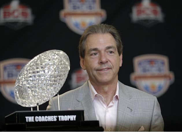 FILE -In a Jan. 8, 2013 file photo Alabama head coach Nick Saban poses with The Coaches' Trophy during a BCS National Championship college football game news conference  in Ft. Lauderdale, Fla. By the