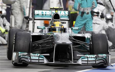 Mercedes Formula One driver Lewis Hamilton of Britain drives in the pit lane after performing a pit stop during the Australian F1 Grand Prix at the Albert Park circuit in Melbourne
