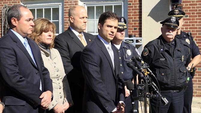 """New Hampshire Assistant Attorney General James Vara, center, gives a news conference in Dover, N.H. on Saturday, Oct. 13, 2012 in Dover, N.H. announcing that University of New Hampshire student, Elizabeth """"Lizzi"""" Marriott who disappeared earlier in the week, is dead, and a man has been charged with second-degree murder. (AP Photo/Jim Cole)"""