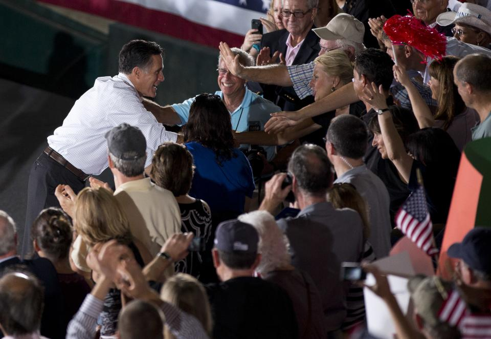 Republican presidential candidate, former Massachusetts Gov. Mitt Romney shakes hands during a campaign rally on Friday, Sept. 7, 2012 in Nashua, N.H.  (AP Photo/Evan Vucci)