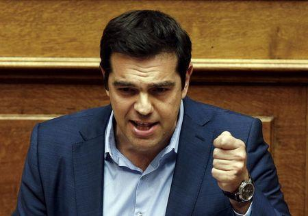 Greek PM Tsipras addresses lawmakers during a parliamentary session in Athens