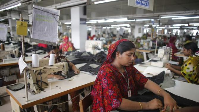 A worker works in a factory of Ananta Garments Ltd in Savar