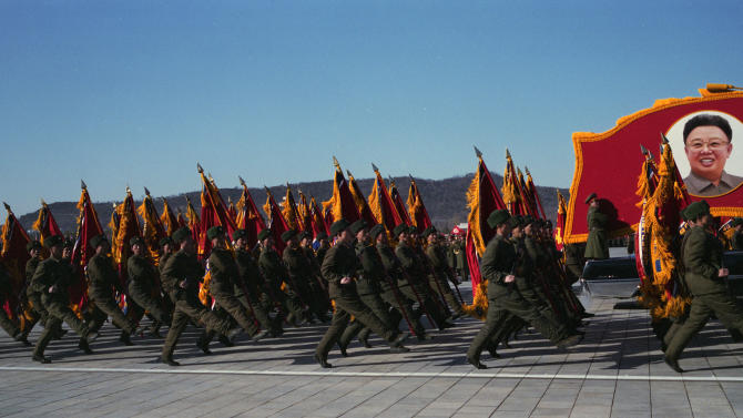 In this Feb. 16, 2012 photo, North Korean soldiers march and carry a portrait of Kim Jong Il during a military parade at Kumsusan Memorial Palace in Pyongyang commemorating what would have been the late North Korean leader's 70th birthday. (AP Photo/David Guttenfelder)