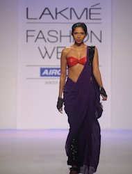 A model showcases a creation by Indian designer Komal Sood on the second day of Lakme Fashion Week (LFW) winter/festive 2012 in Mumbai on August 4, 2012