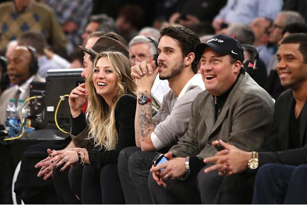 From left, actress Kaley Kuoco, her husband, tennis player Ryan Sweeting, Wheels Up CEO Kenny Dichter and Seattle Seahawks quarterback Russell Wilson attend an NBA basketball game between the Dallas M