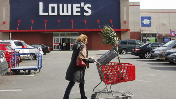 FILE - In this  Feb 21, 2012, file photo, a customer shops at Lowe's in New York. Lowe's said Monday, Nov. 19, 2012, its third-quarter net income surged 76 percent, helped by fewer charges and higher revenue. Its shares rose 5 percent in early premarket trading Monday. (AP Photo/Mark Lennihan, File)